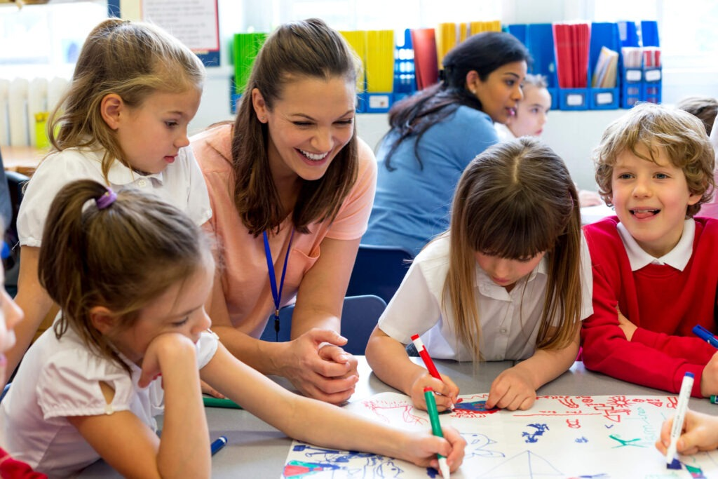 woman teaching boys and girls during summer classes